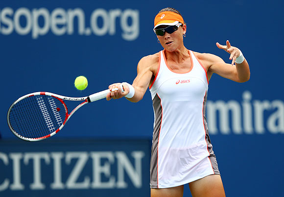 Samantha Stosur returns against Petra Martic in the first round of the US Open on Monday