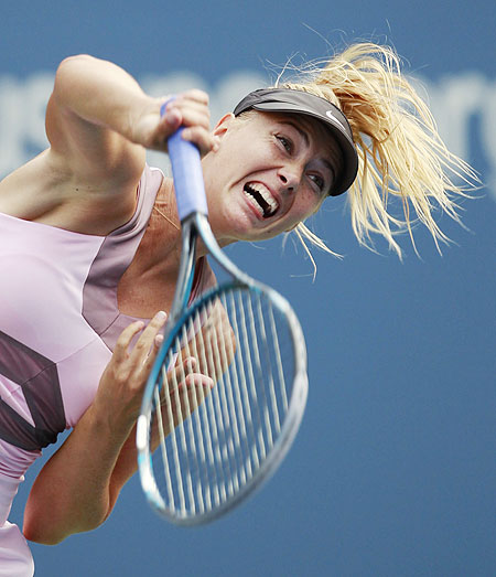 Maria Sharapova serves to Melinda Czink during their women's first round singles match at the US Open on Monday