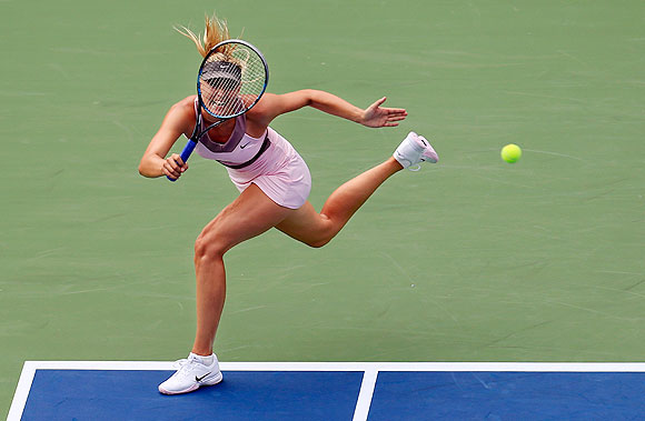 Maria Sharapova plays a forehand against Melinda Czink during their first round match at the US Open on Monday
