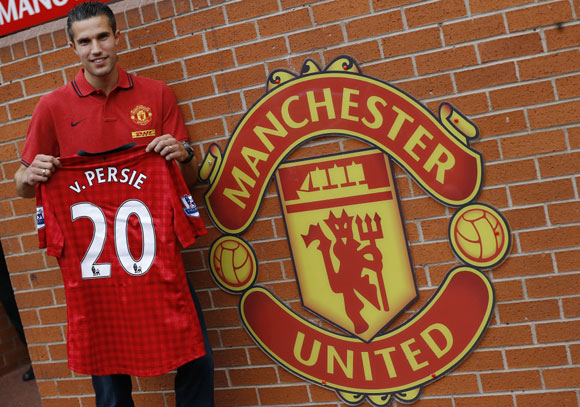 Manchester United's new signing Robin van Persie of the Netherlands poses for photographers at Old Trafford in Manchester