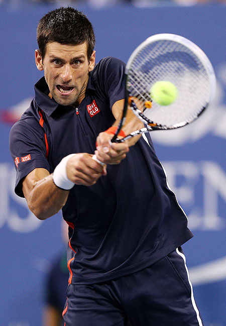 Novak Djokovic returns a shot against Paolo Lorenzi during their first round match on Tuesday