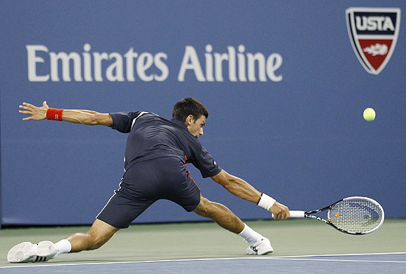 Novak Djokovic returns to Paolo Lorenzi during their first round match on Tuesday