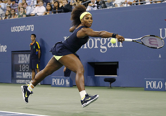 Serena Williams returns a shot to Coco Vandeweghe during their first round match on Tuesday