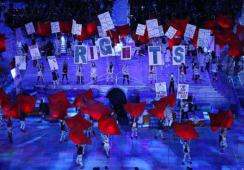 Performers hold placards as they take part at opening ceremony of London 2012 Paralympic Games in Olympic Stadium