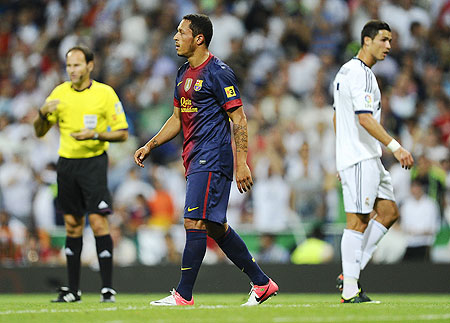 Barcelona's Adriano Correia (centre) leaves the pitch after being shown a red card for a challenge on Cristiano Ronaldo on Wednesday