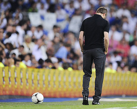 Barcelona coach Tito Vilanova looks a dejected man after the Super Cup second leg match on Wednesday