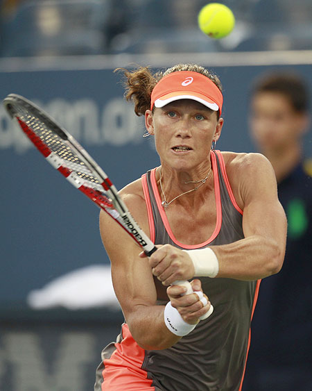 Samantha Stosur of Australia returns a shot to Edina Gallovits-Hall of Romania