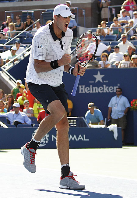 John Isner of the US celebrates after defeating Xavier Malisse of Belgium