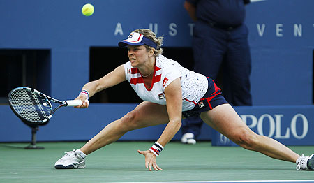 Kim Clijsters of Belgium hits a return to Laura Robson of Britain
