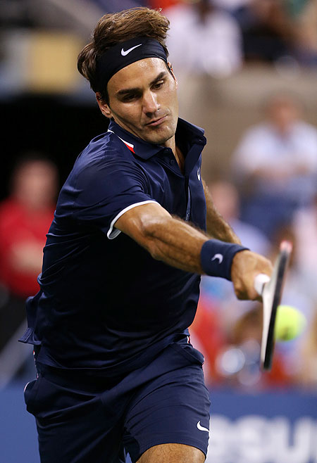 Roger Federer plays a return against Bjorn Phau on Thursday