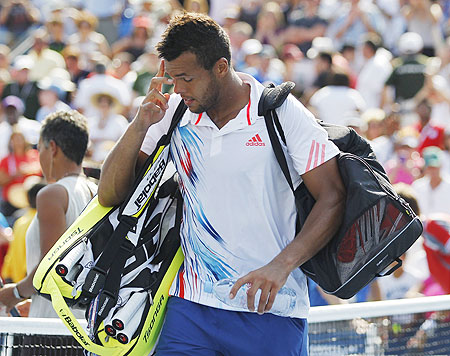 Jo-Wilfried Tsonga leaves the court after his loss to Martin Klizman of Slovakia on Thursday