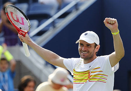 Mardy Fish celebrates after defeating Nikolay Davydenko on Thursday