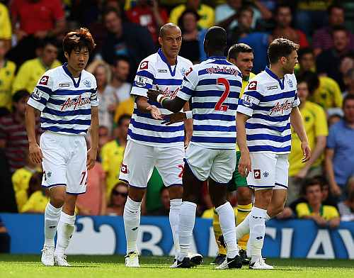 Bobby Zamora of QPR is congratulated on his goal during the Barclays Premier League match against Norwich City