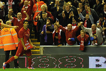 Liverpool's Luis Suarez celebrates after scoring against Hearts during their Europa League match on Thursday
