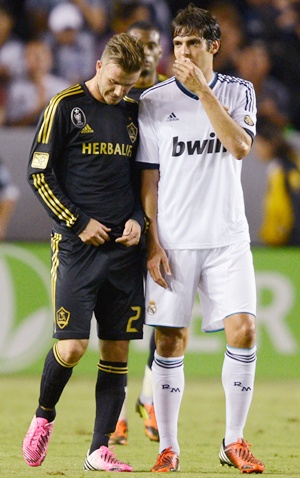 David Beckham of Los Angeles Galaxy (left) with Kaka of Real Madrid