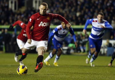 Manchester United's Wayne Rooney shoots to score against Reading during their English Premier League soccer match at the Madejski Stadium in Reading