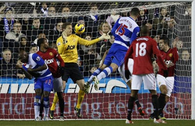 Reading's Sean Morrison (C) scores against Manchester United during their English Premier League soccer match at the Madejski Stadium