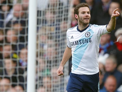 Juan Mata of Chelsea celebrates after scoring his team's first goal against West Ham United during their English Premier League soccer match at Upton Park