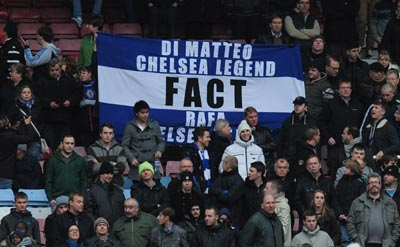 Chelsea fans raise a banner during the Barclays Premier League match between West Ham United and Chelsea at the Boleyn Ground