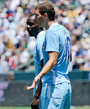Manchester City's Edin Dzeko with teammate Mario Balotelli