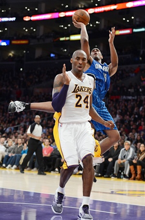 Arron Afflalo of the Orlando Magic with Kobe Bryant
