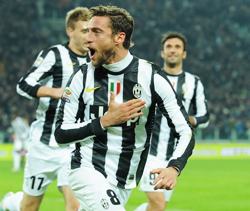 Claudio Marchisio (centre) of Juventus celebrates
