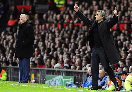 Jose Mourinho (right) gestures as Manchester United manager Alex Ferguson (left) watches