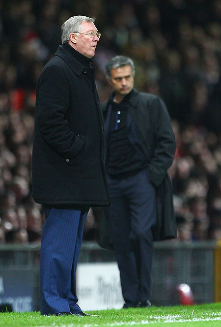 Manchester United Manager Alex Ferguson (left) and Jose Mourinho watch