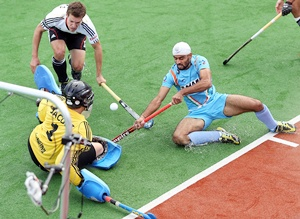 Gurwinder Singh Chandi battles for the ball