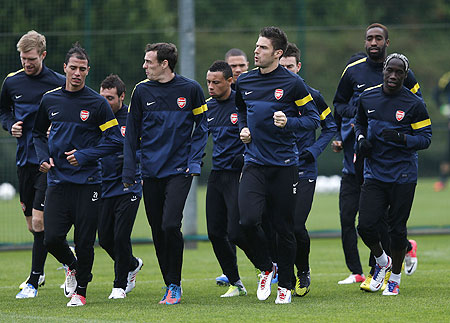 Arsenal players attend a team training session