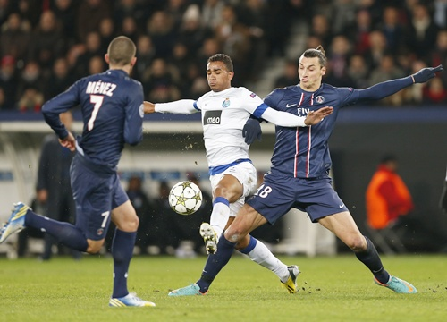 Paris St Germain's Zlatan Ibrahimovic (right) challenges FC Porto's Danilo