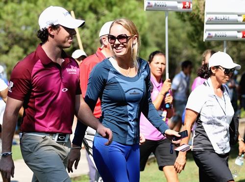 Tennis player, Caroline Wozniacki speaks with boyfriend Rory McIlroy