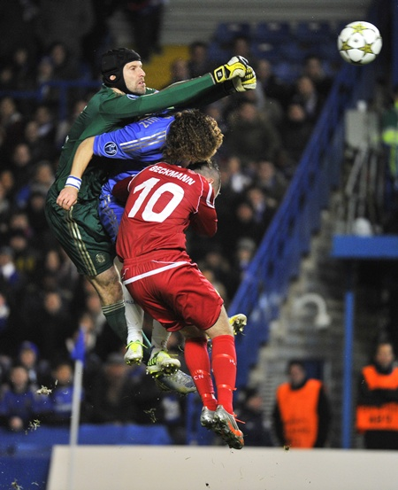 Chelsea's Petr Cech (left) makes a save from FC Nordsjaelland's Mikkel Beckmann