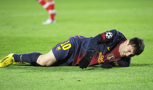 Barcelona's Lionel Messi reacts after picking up an injury