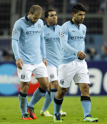 Manchester City's players leave the field after their Champions League group D match on Tuesday