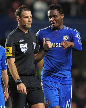 John Obi Mikel talks to ref Mark Clattenburg
