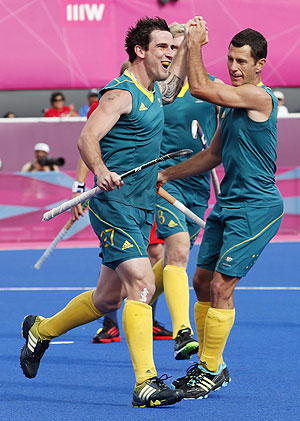 Australia's Kieran Govers (left) celebrates with teammate Jamie Dwyer