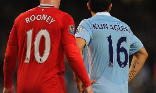 Wayne Rooney of Manchester United and Sergio Aguero of Manchester City