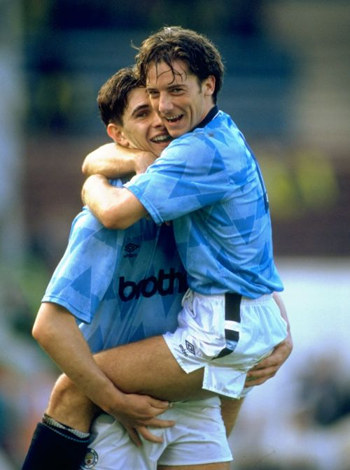 Ian Bishop and Paul Lake of Manchester City celebrate victory against Manchester United