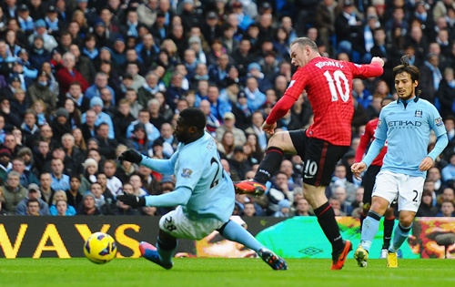 Wayne Rooney of Manchester United scores the second goal
