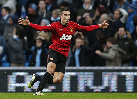 Manchester United's Robin Van Persie celebrates after scoring against Manchester City on Sunday