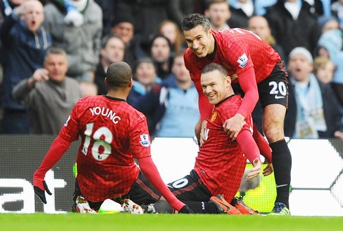 Wayne Rooney celebrates after scoring the opening goal against City on Sunday