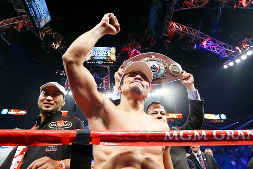 Juan Manuel Marquez celebrates after defeating Manny Pacquiao