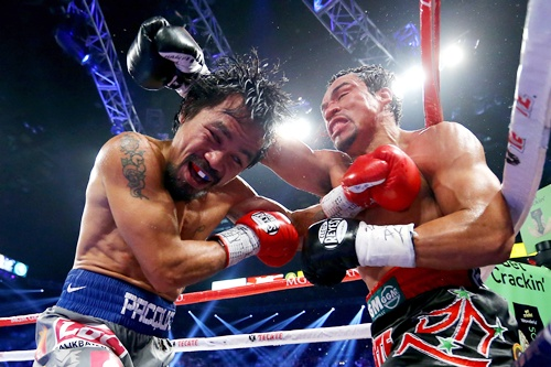 Manny Pacquiao and Juan Manuel Marquez exchange blows