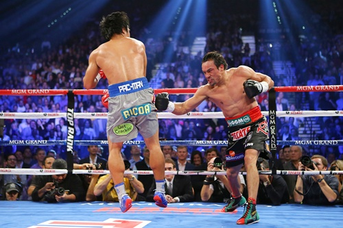 Juan Manuel Marquez throws a right at Manny Pacquiao