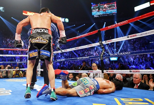 Manny Pacquiao lays face down on the mat after being knocked out