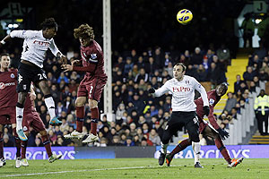Fulham's Hugo Rodallega (left) scores against Newcastle United during their English Premier League match at Craven Cottage in London on Monday