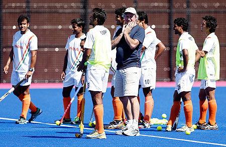 Coach Michael Jack Nobbs of India talks to his team