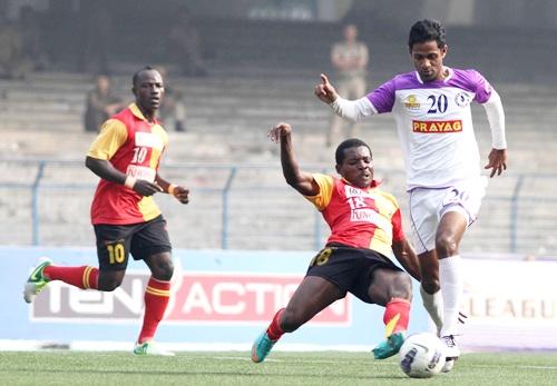 East Bengal's Orji penn tries to stop Prayag United's Asif Kottayil