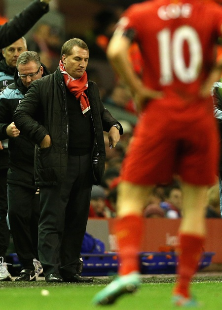 Liverpool manager Brendan Rodgers shows his dejection